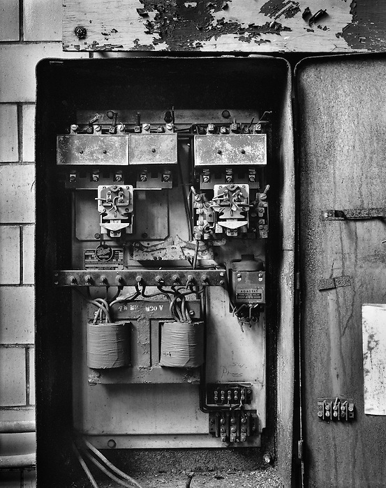 An open control box showing the electrical panel at a power plant