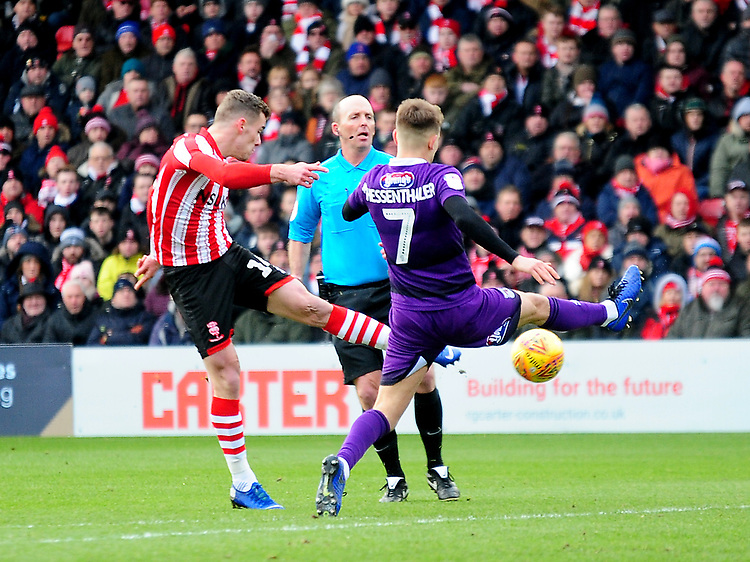 Lincoln City's Harry Toffolo scores the opening goal<br /> <br /> Photographer Andrew Vaughan/CameraSport<br /> <br /> The EFL Sky Bet League Two - Lincoln City v Grimsby Town - Saturday 19 January 2019 - Sincil Bank - Lincoln<br /> <br /> World Copyright &copy; 2019 CameraSport. All rights reserved. 43 Linden Ave. Countesthorpe. Leicester. England. LE8 5PG - Tel: +44 (0) 116 277 4147 - admin@camerasport.com - www.camerasport.com