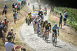The breakaway group in action on the cobbles during Stage 9 of the 2018 Tour de France running 156.5km from Arras Citadelle to Roubaix, France. 15th July 2018. <br /> Picture: ASO/Pauline Ballet | Cyclefile<br /> All photos usage must carry mandatory copyright credit (&copy; Cyclefile | ASO/Pauline Ballet)
