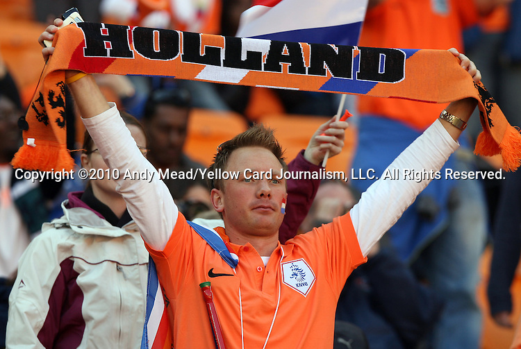 14 JUN 2010:  Dutch fan in the stands with a Holland scarf.  The Netherlands National Team played the Denmark National Team at Soccer City Stadium in Johannesburg, South Africa in a 2010 FIFA World Cup Group E match.