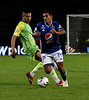 BOGOTÁ-COLOMBIA, 03–08-2019: David Macalister Silva de Millonarios y Pablo Rojas de Jaguares de Córdoba F.C. disputan el balón, durante partido entre Millonarios y Jaguares de Córdoba F.C. de la fecha 4 por la Liga Águila II 2019  jugado en el estadio Nemesio Camacho El Campín de la ciudad de Bogotá. / David Macalister Silva of Millonarios and Pablo Rojas of Jaguares de Cordoba F. C. figth for the ball, during a match between Millonarios and Jaguares de Cordoba F. C. of the 4th date for the Aguila Leguaje II 2019 played at the Nemesio Camacho El Campin Stadium in Bogota city, Photo: VizzorImage / Luis Ramírez / Staff.