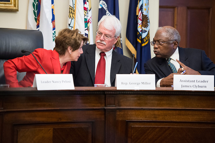 "UNITED STATES - OCTOBER 2: From left, House Minority Leader Nancy Pelosi, D-Calif., Rep. George Miller, D-Calif., and Assistant Minority Leader James Clyburn, D-S.C., talk during the House Democratic Steering and Policy Committee hearing on ""Saving Medicare for Seniors Today and in the Future,"" in the Cannon House Office Building on Tuesday, Oct. 2, 2012. (Photo By Bill Clark/CQ Roll Call)"
