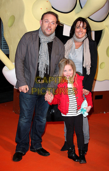 "JOHN THOMSON, wife SAMANTHA SHARPE & daughter OLIVIA.At the ""Spongebob Squarepants - The Sponge who could Fly"" Gala performance at the Hammersmith Apollo, London, England, .March 5th 2009.musical full length family husband grey gray jacket scarf red jeans child black and white print leggings boots .CAP/ROS.©Steve Ross/Capital Pictures"