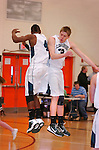 Lewisburg High School basketball players celebrate with a mid air bunp.