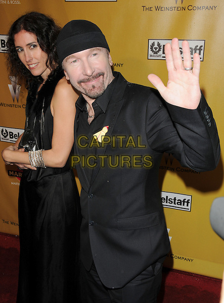 MORLEIGH STEINBERG & U2 - THE EDGE (David Howell Evans) .At Weinstein Company Post Golden Globe Party held at Bar210 & Plush Ultra Lounge in Beverly Hills, California, USA. January 17th, 2010                                                                   globes half length black suit dress hand palm waving married husband wife goatee facial hair beanie hat.CAP/DVS.©Debbie VanStory/Capital Pictures