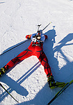 Martin Eng of Norway collapses with exhaustion after finishing his race at The International Biathlon Union Cup # 7 Men's 10 KM Sprint held at the Canmore Nordic Center in Canmore Alberta, Canada, on Feb 16, 2012.  Martin finished in forth position in the sprint.  Photo by Gus Curtis.