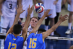 LOS ANGELES - MAY 5:  Kyle Ensing #5 of the Long Beach State 49ers spikes the ball against Dylan Missry #12 and Daenan Gyimah #16 of the UCLA Bruins during the Division 1 Men's Volleyball Championship on May 5, 2018 at Pauley Pavilion in Los Angeles, California. The Long Beach State 49ers defeated the UCLA Bruins 3-2. (Photo by John W. McDonough/NCAA Photos via Getty Images)