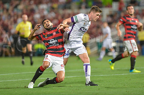 26.02.2016. Pirtek Stadium, Parramatta, Australia. Hyundai A-League. Western Sydney Wanderers versus Perth Glory. Wanderers midfielder Dimas looks for a penalty from a challenge by Perth defender Alex Grant.