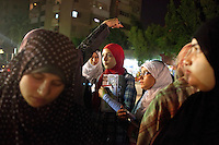 Egypt / Cairo / 10.6.2012 / Rhada, a 40-year-old Muslim Sister, points as she explains the rules of working on the spot to a group of young Muslim Sisters. The group, more accustomed to rallying in Cairo's more affluent Nasr City district, is preparing to hand out leaflets about Mohammad Morsi on the streets of El Taba, one of Cairo's poorer neighborhoods. El Taba, Cairo. Egypt, June 2012.<br /> <br /> © Giulia Marchi