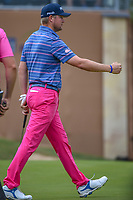 Trey Mullinax (USA) gives a celebratory fist bump after sinking his birdie putt on 18 and setting a new course record of 62  during Round 3 of the Valero Texas Open, AT&amp;T Oaks Course, TPC San Antonio, San Antonio, Texas, USA. 4/21/2018.<br /> Picture: Golffile   Ken Murray<br /> <br /> <br /> All photo usage must carry mandatory copyright credit (&copy; Golffile   Ken Murray)
