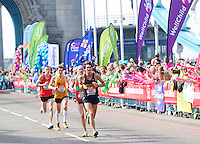 17 APR 2011 - LONDON, GBR - Runners, led by Andrew Greenleaf, pass charity cheer points as they cross Tower Bridge during the London Marathon (PHOTO (C) NIGEL FARROW)