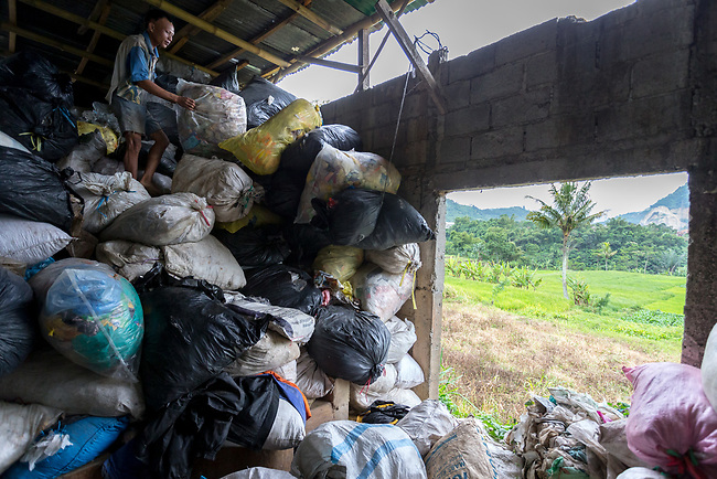 29 JAN, 2018, Bandung, Indonesia: Rubbish collector Dodo Hermawan (32),at a recycle collection point where river scavengers come to deposit the trash collected from the Citarum river. The Citarum river, listed as one of the most polluted rivers in the world.  It will soon be the main water supply system for Jakarta as the bores that have been dug into the aquifers dry but it also supports agriculture, fishery, industry, sewerage and electricity.  The Indonesian Government is moving to urgently try to clean the system up but it is fighting massive infrastructure issues and toxic industrial dumping.    Picture by Graham Crouch/The Australian