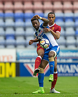 Omar Bogle of Wigan Athletic & Joel Matip of Liverpool during the pre season friendly match between Wigan Athletic and Liverpool at the DW Stadium, Wigan, England on 14 July 2017. Photo by Andy Rowland.
