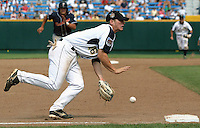 Georgia Tech's Whit Robbins scoops up a ground ball to force Cal State Fullerton's Joe Turgeon out at third base and end the eighth-inning of game five of the 2006 College World Series at Rosenblatt Stadium in Omaha. (Photo by Michelle Bishop) ..