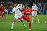 Cardiff City Stadium, Cardiff, South Wales - Tuesday 12th Aug 2014 - UEFA Super Cup Final - Real Madrid v Sevilla - <br /> <br /> Real Madrid&rsquo;s Pepe battles with Sevilla&rsquo;s Carlos Bacca<br /> <br /> <br /> <br /> Photo by Jeff Thomas/Jeff Thomas Photography