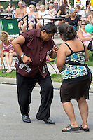 Impromptu Salsa Dancing at Sunfest  by Hispanic couple