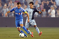 Davy Arnaud (22) midfield   Montreal Impact watched by Benny Feilhaber (10) midfield Sporting KC ..Sporting Kansas City defeated Montreal Impact 2-0 at Sporting Park, Kansas City, Kansas.