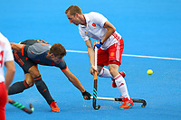 Netherlands Sander de Wijn tackles England's Barry Middleton during the Hockey World League Semi-Final match between England and Netherlands at the Olympic Park, London, England on 24 June 2017. Photo by Steve McCarthy.