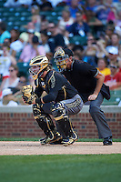 Thomas Dillard (7) of Oxford High School in Greenwood, Mississippi and umpire Mike Droll during the Under Armour All-American Game on August 15, 2015 at Wrigley Field in Chicago, Illinois. (Mike Janes/Four Seam Images)