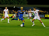 AFC Wimbledon's Lyle Taylor shoots at goal during the Sky Bet League 1 match between AFC Wimbledon and MK Dons at the Cherry Red Records Stadium, Kingston, England on 22 September 2017. Photo by Carlton Myrie / PRiME Media Images.