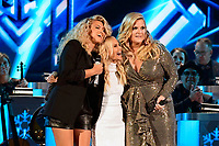 25 September 2019 - Nashville, Tennessee - Tori Kelly, Kristin Chenoweth, Trisha Yearwood. 2019 CMA Country Christmas held at the Curb Event Center. Photo Credit: Dara-Michelle Farr/AdMedia
