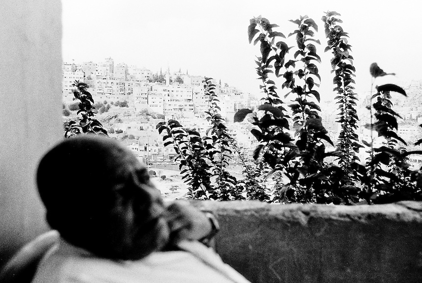 Jaddou, from Baghdad, sits on his small balcony in Amman, September 2009. He fled his home in Baghdad after repeated threats to his family from sectarian militias. Iraqi refugees across the Middle East are highly likely to end up moving through 'irregular' people smuggling networks to Europe, North America and Australia due to the often dire circumstances faced in countries like Jordan. Photo: Ed Giles.
