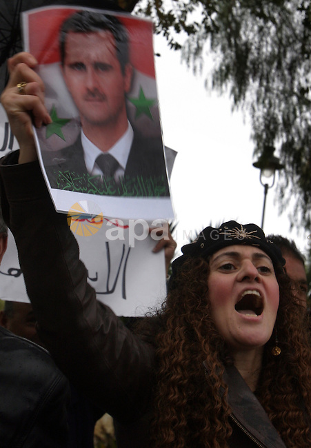Israel Arabs and Palestinians protest against US in front of the American consulate during a demonstration in support for the Syrian President Bashar al-Assad in west Jerusalem on November 19, 2011. Photo by Mahfouz Abu Turk