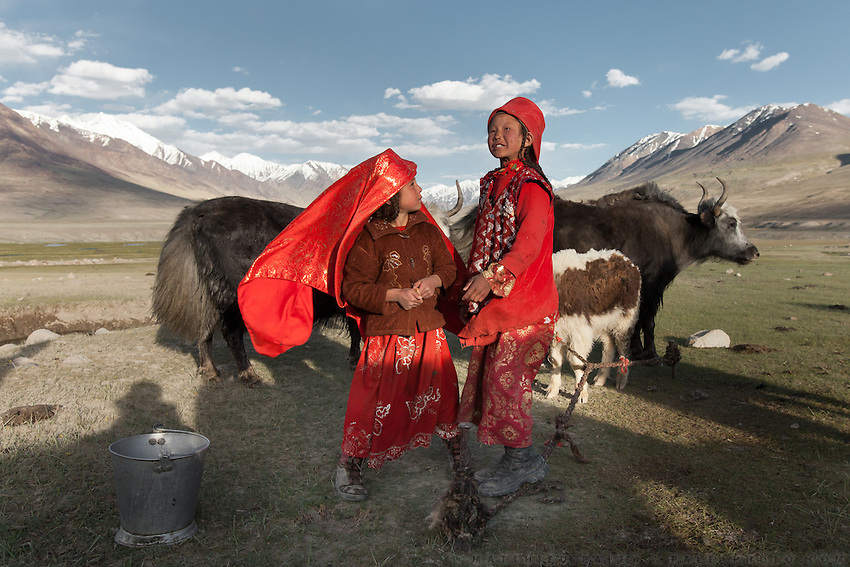 Two Kyrgyz girls milking yaks in the evening..At the Kyrgyz settlement of Bozoi Gumbaz, before Chaqmaqtin lake, Amon Boi's camp...Trekking through the high altitude plateau of the Little Pamir mountains (average 4200 meters) , where the Afghan Kyrgyz community live all year, on the borders of China, Tajikistan and Pakistan.