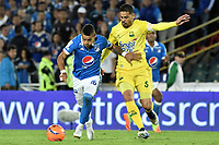BOGOTA - COLOMBIA -04 -06-2017: Ayron del Valle (Izq) jugador de Millonarios disputa el balón con Yulian Anchico (Der) jugador de Atlético Bucaramanga durante partido de vuelta  partido de vuelta por los cuadrangulares finales de la Liga Aguila I 2017 jugado en el estadio Nemesio Camacho El Campin de la ciudad de Bogota. / Ayron del Valle (L) player of Millonarios fights for the ball with Yulian Anchico (R) player of Atletico Bucaramanga during secong leg match for the final quadrangulars of the Liga Aguila I 2017 played at the Nemesio Camacho El Campin Stadium in Bogota city. Photo: VizzorImage / Gabriel Aponte / Staff.