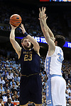 CHAPEL HILL, NC - FEBRUARY 12: Notre Dame's Martinas Geben (LTU) (23) shoots over North Carolina's Luke Maye (32). The University of North Carolina Tar Heels hosted the University of Notre Dame Fighting Irish on February 12, 2018 at Dean E. Smith Center in Chapel Hill, NC in a Division I men's college basketball game. UNC won the game 83-66.