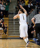 Justin Cobbs of California celebrates after making three points during the game against UCSB Gauchos at Haas Pavilion in Berkeley, California on December 19th, 2011.   California defeated UC Santa Barbara, 7-50.