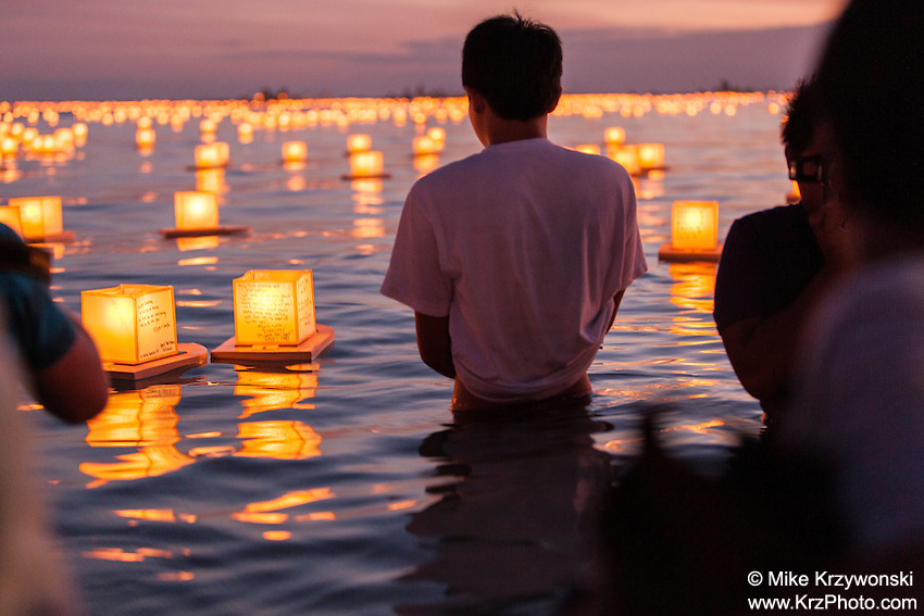 Spectators watching lanterns floating in the water during the 15th Annual Lantern Floating Ceremony at Ala Moana Beach Park in Honolulu on Memorial Day