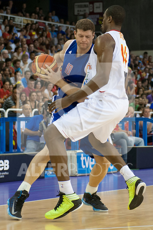 Spain's Serge Ibaka and Great Britain's Robert Archibald during friendly match.July 9,2012.(ALTERPHOTOS/Ricky)