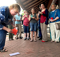 Janelle Jessen/Herald-Leader<br /> Charlie Muessemeyer, director of the Dogwood Literacy Council, unveiled two bricks in the sidewalk in front of the council honoring longtime volunteers Annie Bassett and Lucy McLane on Thursday. The council also celebrated this semesters volunteers during the evening.