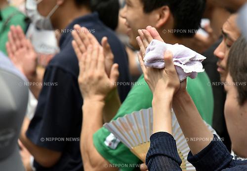July 2, 2016, Tokyo, Japan - Supporters of the Japanese Communists Party rally behind its leader Kazuo Shii during his campaign for a local candidate from his party in Tokyos Shinjuku on sweltering Sunday, July 2, 2016. The Communists, Democrats?and other opposition parties agreed to avoid having their candidates?compete against one another in single-seat districts, the Communists field 42 candidates only for proportional representation seats. (Photo by Natsuki Sakai/AFLO) AYF -mis-