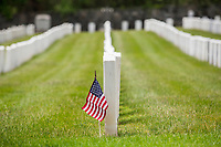 NEW YORK, NY - MAY 25: View of a U.S flag in front of the graves of American soldiers at the Cypress Hill Military Cemetery on May 25, 2020 in Brooklyn, NY. Memorial Day is an American holiday that commemorates the men and women who died while serving in the United States Army. Today this date is celebrated during the Covid-19 pandemic that has caused thousands of deaths in the United States and around the world. (Photo by Pablo Monsalve / VIEWpress)