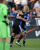 Chris Wondolowski of Earthquakes celebrates with Steven Lenhart of Earthquakes after scoring a goal during the first half of the game against the WhiteCaps at Buck Shaw Stadium in Santa Clara, California on July 20th, 2011.  Earthquakes and WhiteCaps are tied 1-1 at halftime.