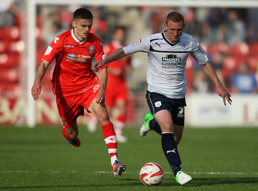 Preston North End's Stuart Beavon battles with Walsall's Jamie Paterson..Football - npower Football League Division One - Walsall v Preston North End - Saturday 22nd September 2012 - Banks's Stadium - Walsall..