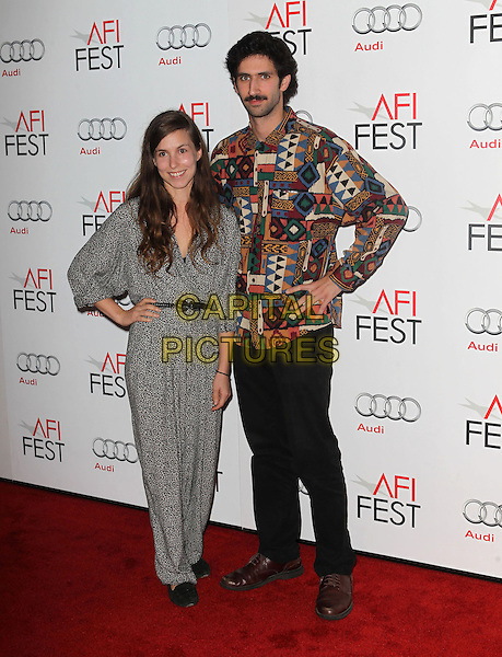 Sophia Takal & Zach Weintraub.AFI FEST 2012 'On The Road' gala screening, Grauman's Chinese Theatre, Hollywood, California, USA..3rd November 2012.full length dress black grey gray pattern shirt hand on hip trousers moustache mustache facial hair .CAP/ADM/KB.©Kevan Brooks/AdMedia/Capital Pictures.