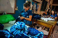 A Salvadoran woman stuffs a decorative pillow, dyed with a natural blue indigo, in an artisanal clothing workshop in Santiago Nonualco, El Salvador, 6 April 2018. For centuries, indigo, a natural deep blue dye extracted from the leaves of tropical plants, has been known to the native indigenous inhabitants of Central America. Nowadays, a growing demand for handmade, nature-based products has has permitted the emergence of various clothing workshops and cooperatives. Employing traditional design techniques and inspired by the ancient Mayan artists, they produce fashion collections, clothing accessories or decorative items on a sustainable, small scale basis.