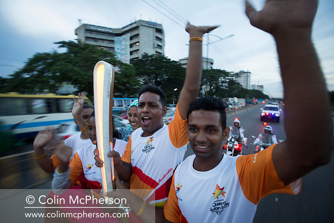 The Queen's Baton Relay arrived today in Bangladesh on the first of a three-day visit to the country. This Queen's Baton Relay will engage with all 70 nations and territories of the Commonwealth, over 388 days and cover 230,000km. It will be the longest Relay in Commonwealth Games history, finishing at the Opening Ceremony on the Gold Coast on 4th April 2018. Photograph shows Asif Hossain Khan (left, 10m air rifle shooting, Manchester 2002 gold, Melbourne 2006 silver, Delhi 2010 bronze) and Mohammad Tamimul Islam (archery, Commonwealth Youth Games Samoa 2015) and fellow athletes in an open-topped jeep carrying the Baton from the international airport in Dhaka.