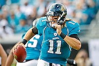 November 27, 2011:  Jacksonville Jaguars quarterback Blaine Gabbert (11) scrambles out of the pocket during second half action between the Jacksonville Jaguars and the Houston Texans played at EverBank Field in Jacksonville, Florida.  Houston defeated Jacksonville 20-13.........