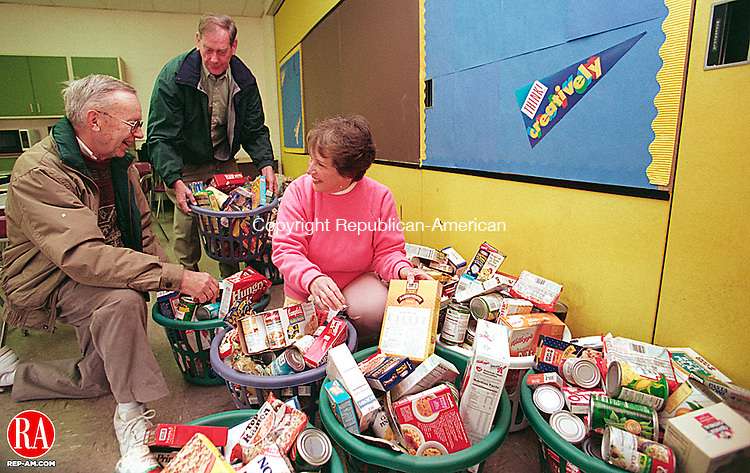 OXFORD, CT 11/25/98--1125TK03.tif  (left to right:)As part of a 29-year annual tradition, Oxford retired School teachers Gene Navetski, Bill Velms and Pauline Manville picked up food baskets at the Great Oak Middle School in Oxford Wednesday morning. The baskets  were delivered to 26 seniors and 16 families for Thanksgiving.--TOM KABELKA staff photo for  STANDALONE PHOTO  (Filed in Scans/Scan-In)