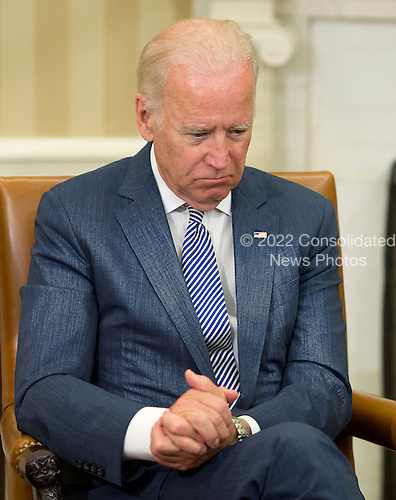 United States Vice President Joe Biden listens as US President Barack Obama makes remarks to the media after receiving an update on the investigation into the attack in Orlando, Florida in the Oval Office of the White House in Washington, DC on Monday, June 13, 2016. <br /> Credit: Ron Sachs / Pool via CNP