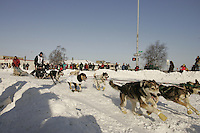 March 3, 2007   Bill Pinkham's team takes the turn at Cordova street during the Iditarod ceremonial start day in Anchorage