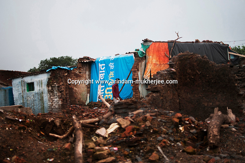 A man walks through the rubble of destroyed houses at Bokapahari, Jharia. A huge coal mine fire is engulfing the city of Jharia from all its sides. All scientific efforts have gone in vain to stop this raging fire. This fire is affecting lives of people living in and around Jharia. Jharkhand, India. Arindam Mukherjee