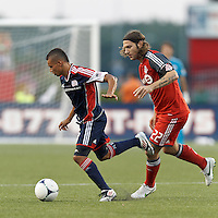 New England Revolution substitute forward Fernando Cardenas (80) dribbles as Toronto FC midfielder Torsten Frings (22) defends. In a Major League Soccer (MLS) match, Toronto FC defeated New England Revolution, 1-0, at Gillette Stadium on July 14, 2012.