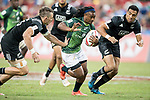 Branco Du Preez of South Africa runs with the ball while New Zealand players including Lewis Ormond (left) try to stop him during the match South Africa vs New Zealand, Day 2 of the HSBC Singapore Rugby Sevens as part of the World Rugby HSBC World Rugby Sevens Series 2016-17 at the National Stadium on 16 April 2017 in Singapore. Photo by Victor Fraile / Power Sport Images
