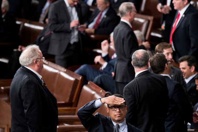 UNITED STATES - FEBRUARY 28: Rep. Keith Ellison, D-Minn., looks up to the gallery as he waits for President Donald Trump to deliver his address to a joint session of Congress on Tuesday, Feb. 28, 2017. (Photo By Bill Clark/CQ Roll Call)