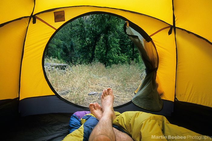 Relaxing in tent, Oak Creek Canyon, near Sedona, Arizona